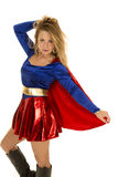 Super woman hold back cape hand in hair stock photo