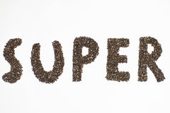 Super word made of chia seeds in white background stock image