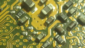 Super (10x) Macro Camera Dolly along a computer circuit board, starting on a lower corner then moving laterally.Shot with special stock footage