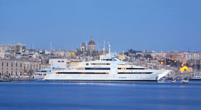 Super yacht in a marina. A super yacht berthed in a marina in malta Stock Images