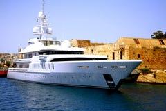 Super yacht, Valletta, Malta. One of the many super yachts moored In Marsamxett harbor, Valletta, Malta Stock Photo