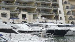 Super yachts moored at Portomaso Marina, Malta stock video footage