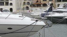 Super yachts moored at Portomaso Marina, Malta stock video