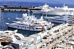 Super yachts, sailing boats and ships in a sea port Stock Images