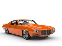 Superb orange vintage muscle car. Beauty shot Royalty Free Stock Image