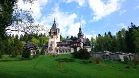 Superb Peles castle in the mountains of Romania Stock Photography