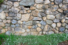 Superb stone-built wall. With grass on foot Royalty Free Stock Photo