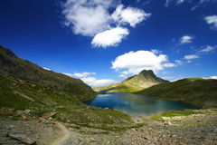Superb trail mountain landscape. Superb mountain landscape in the alps by a sunny day with a trail Stock Image