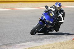Superbike #54. High speed Superbike on the circuit ? Kyalami, South Africa ? Movement on elements of the image. Trackday (all Logos and Trademarks removed stock photos