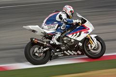Superbike Bmw. Rider:Ruben Xaus Team:BMW Motorrad Motorsport Bike: BMW S1000 RR Event:World Superbike Championships 2009 Place:Kyalami South Africa The return of royalty free stock photos