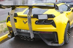 Corvette Z06 Supercar. Supercar corvette Z06 supercharged Yellow parked on the street on a rainy day - by alandi tuning royalty free stock images
