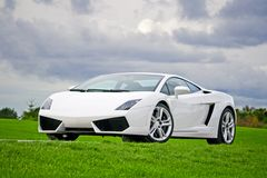 Supercar in golf club Stock Image