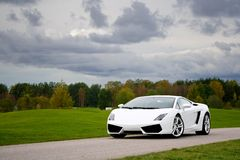 Supercar in golf club Stock Images