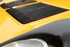 Classic Lamborghhini supercar hood vents. Yellow super car hood vents in shallow depth of field royalty free stock photos