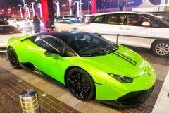 Supercar Lamborghini huricane greeen color. DUBAI, UAE - december 23, 2017: Supercar Lamborghini huricane greeen color parked next to Dubai mall. Lamborghini is Royalty Free Stock Photo