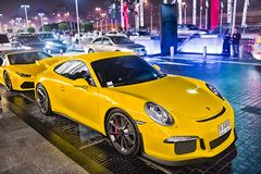Supercar Porsche 911 Carrera 4 GTS huricane yellow color. DUBAI, UAE - december 23, 2017: luxury Supercar Porsche 911 Carrera 4 GTS yellow color parked next to Stock Image