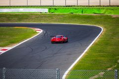 A supercar is running on the track during the race royalty free stock photo