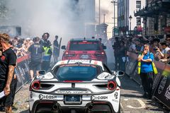 Supercars Burning Tires at the Start royalty free stock photo