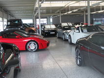 Supercars. Garage of dream, rich man toys Royalty Free Stock Photography
