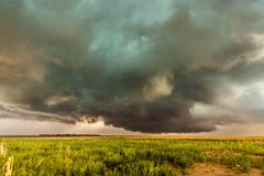 Supercell inflow with green hail glow. A large tornadic mesocyclone supercell inflow with a green glow of hail sucks in energy as it begins to transform into a royalty free stock photo