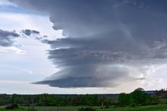 Supercell thunderstorm cloud. With dramatic sky and striations from wind shear stock photo