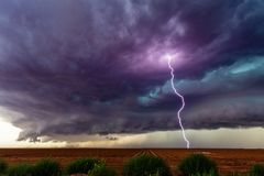 Supercell thunderstorm with dark clouds and lightning. royalty free stock photos