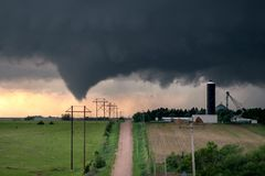 Tornado in central Nebraska. This supercell thunderstorm produces a funnel cloud and soon to be tornado. This storm went on to produce three other tornadoes as royalty free stock image