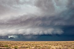 Supercell thunderstorm with wall cloud. Supercell thunderstorm with wall cloud, dark sky, and dramatic storm clouds royalty free stock photography