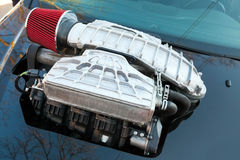 Supercharger, air compressor on a car hood Royalty Free Stock Image
