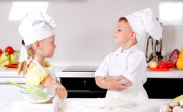 Supercilious little boy chef Stock Photo