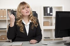 Supercilious young businesswoman Stock Photography