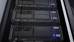 Supercomputer camera in motion. Datacenter rack blue light. Big data and information technology concept.
