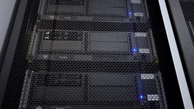Supercomputer camera in motion. Datacenter rack blue light. Big data and information technology concept