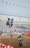 Supercross at Daytona. 43 - Weston L Peick, 45 - Lance Vincent and 903 - Antonio Balbi jumping at the Daytona Supercross race stock images