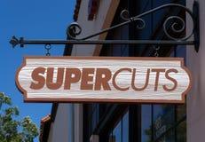 Supercuts-Friseursalon-Speicher und Zeichen stockfotos