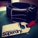 Superdry leather belt. Genuine leather belt Royalty Free Stock Photos