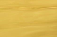 Superfície amarela da água Fotografia de Stock