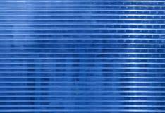 Superfície azul do policarbonato com objetos atrás fotografia de stock royalty free