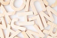 Superfície coberta com as letras de madeira Fotos de Stock Royalty Free