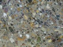 Superfície cortada da textura colorida dos mármores da exibição concreta foto de stock