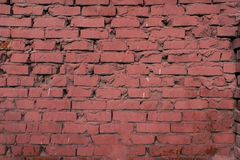 A superfície da parede de tijolo tingiu a pintura vermelha Foto de Stock