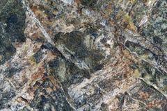 A superfície da pedra do granito com raias, pontos e testes padrões de cores diferentes Foto de Stock Royalty Free
