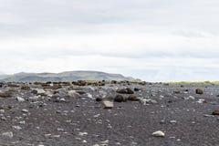 superfície da praia da lava da areia do preto de Reynisfjara Fotos de Stock