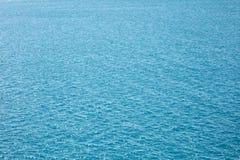 Superfície de brilho do mar da água Fundo abstrato da textura foto de stock