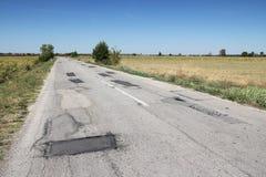 Superfície de estrada danificada Fotos de Stock