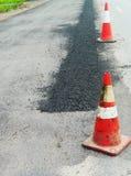 Superfície de estrada que repara trabalhos Imagens de Stock Royalty Free