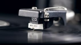 Superfície de um registro de vinil com o cartucho filme