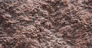 A superfície de uma parede do cimento misturou com o cascalho Imagens de Stock Royalty Free
