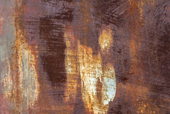 Superfície do ferro oxidado com os restos do fundo velho da textura da pintura imagens de stock royalty free