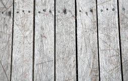 Superfície do fundo da textura com riscos e pregos ou velho de madeira Fotografia de Stock